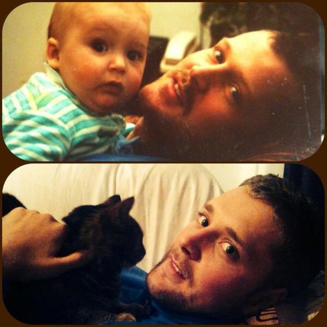Padre e hijo cargando gato y bebé