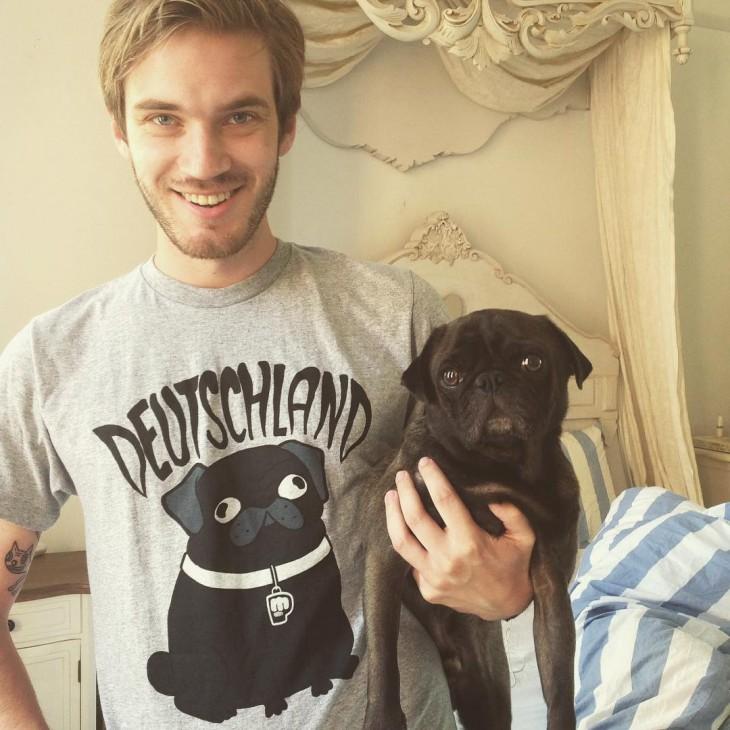 PewDiePie holding black pug