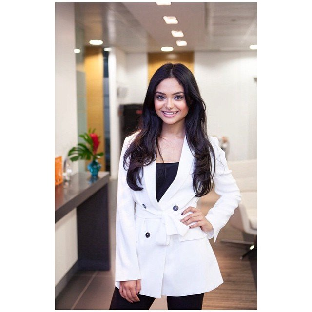 Afshan Azad white coat smile