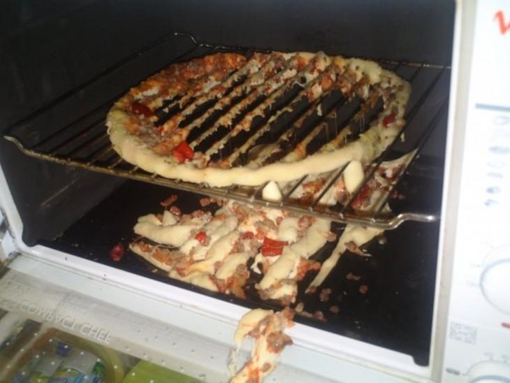 Pizza cae en el horno