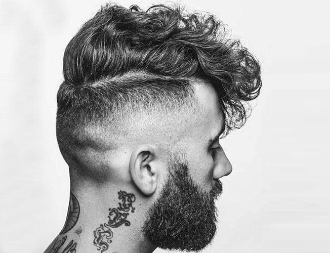 este tipo de corte de pelo es una o dos pulgadas ms largo en la parte superior con un fade gradual hacia una parte ms corta en la parte posterior y los