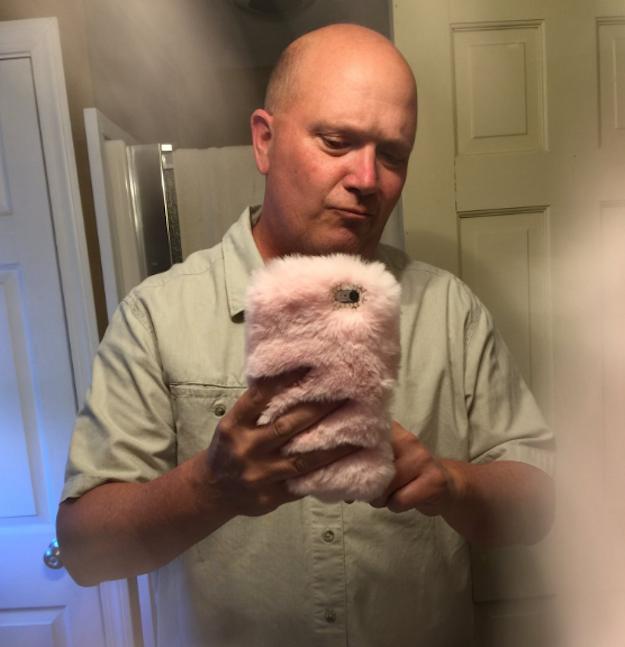 señor selfie telefono peluche