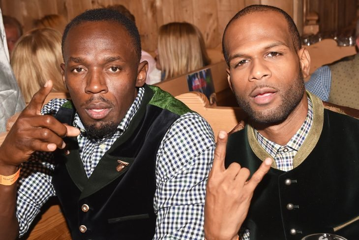Usain Bolt y Germaine Mason en un bar